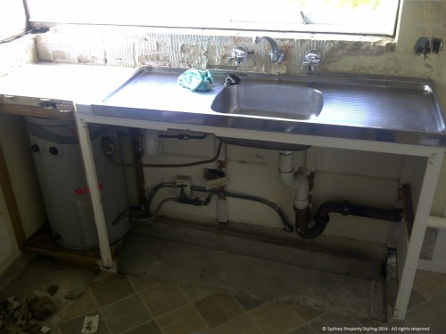 Unit Renovation - Cronulla - February 2014 - WIP 2 - old sink + hot water tank