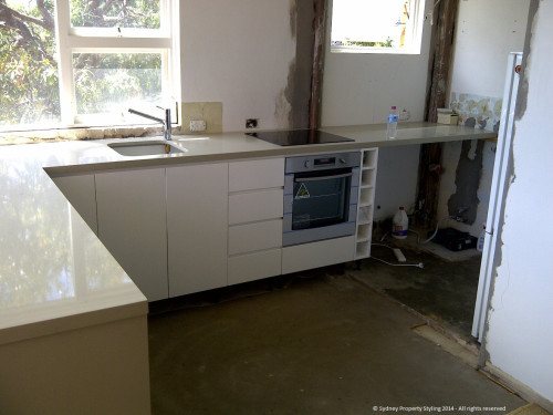 Unit Renovation - Cronulla - February 2014 - WIP 6 - new countertop extends into laundry area